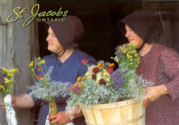 smiling Mennonite ladies offering flowers for sale