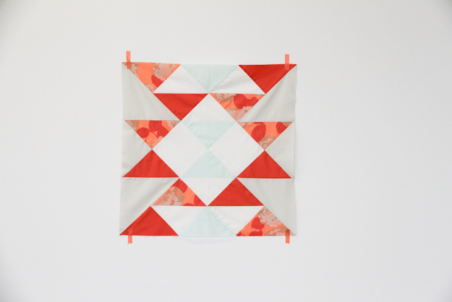 modern mint and coral aztec quilt top taped to wall   by Lovely and Enough