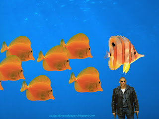 Desktop Wallpaper of Vin Diesel with two guns in Fishes Aquarium Wallpaper