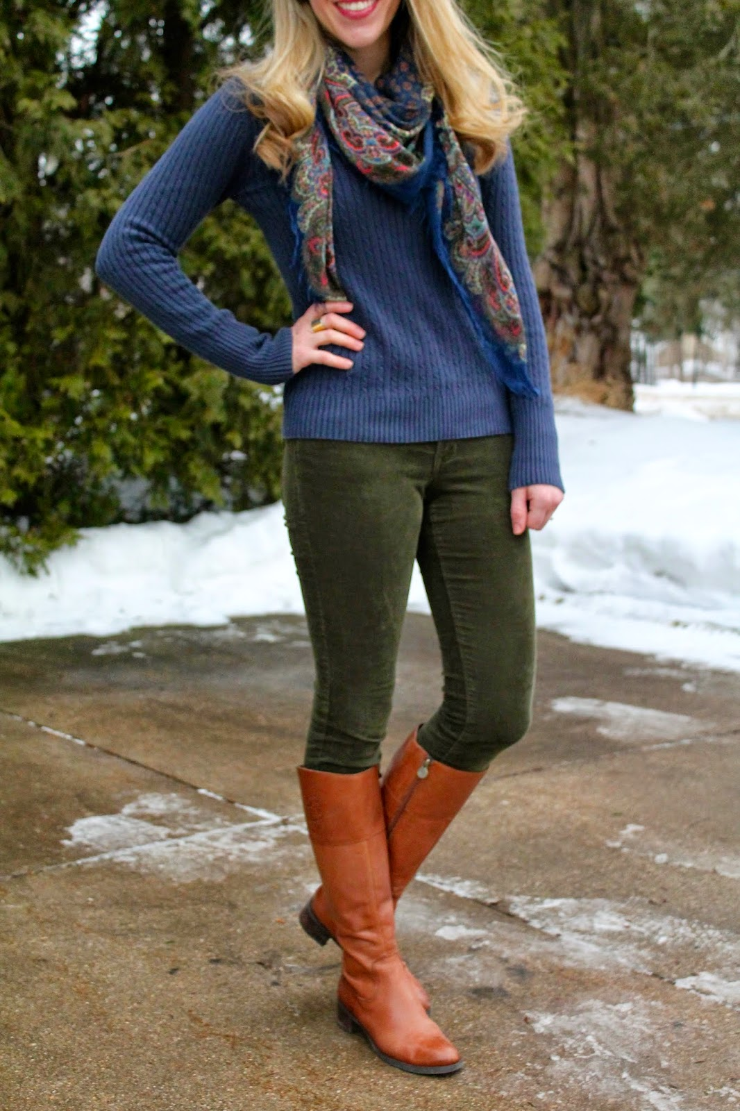 olive corduroy pants and navy sweater