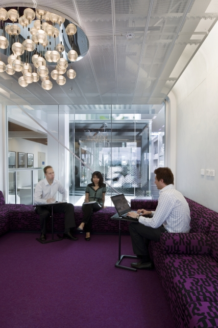 Photo of relaxing room with purple furniture