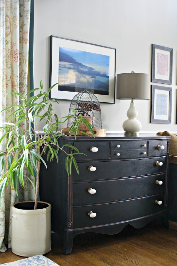 white knobs black dresser