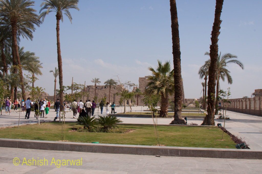 Tourists walking towards the front section of the Karnak temple in Luxor