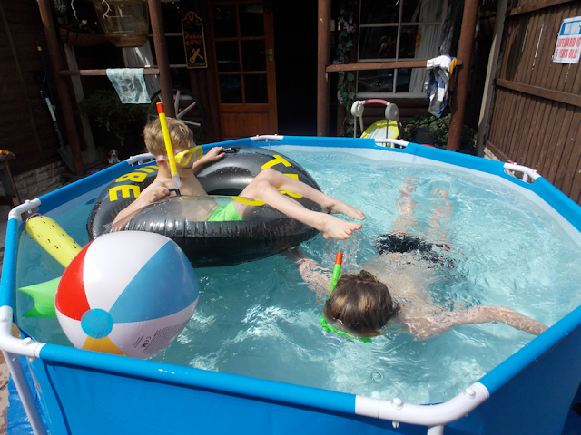 playing with snorkels and floats in the pool