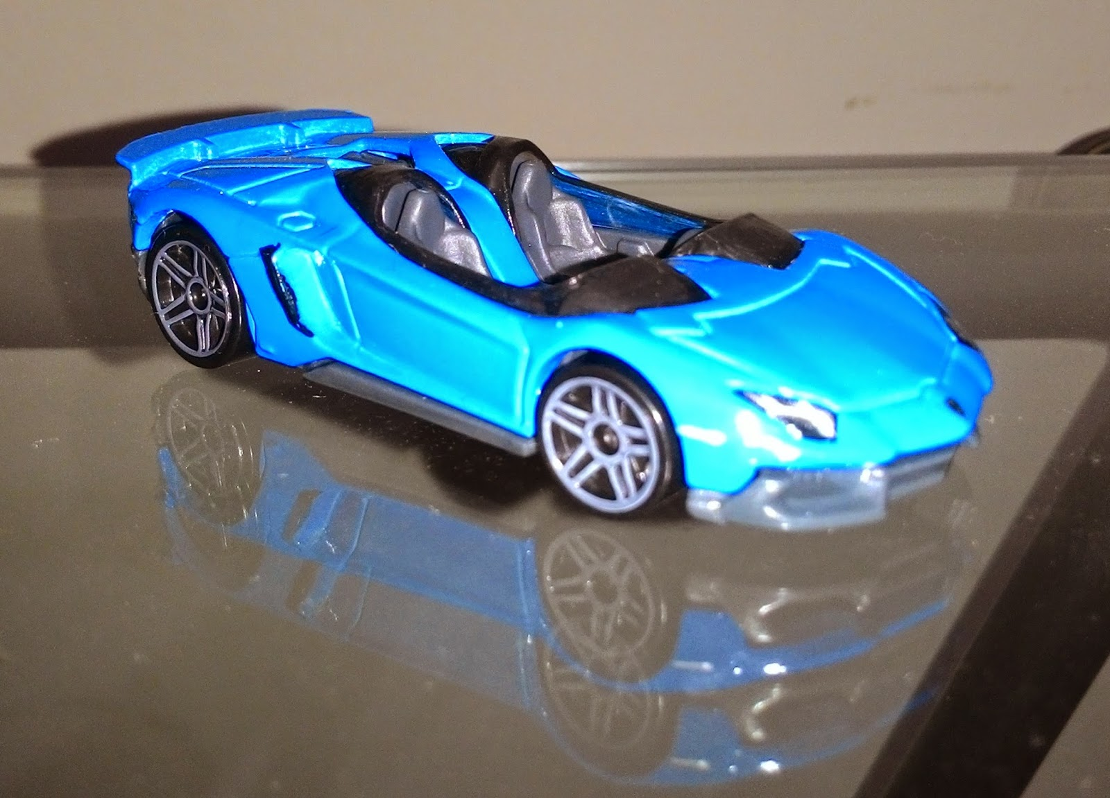 its lamborghini aventador j i have two color of them blue and yellow they are part of 2014 hw workshop ive got them in a little toy store