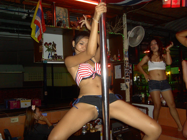 The bar girls of Pattaya dance seductively semi naked in many instances to draw customers in to the bars