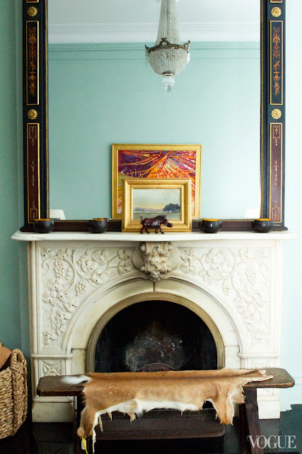 Green blue paint form Farrow & Ball, a large painted mirror, and a Swedish crystal chandelier