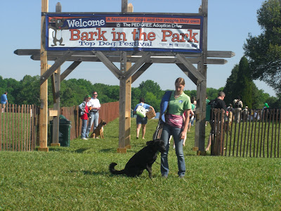Picture of Rudy & I beside the Bark in the Park sign