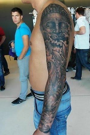 pretty cool Buddha tattoo covered the whole arm.