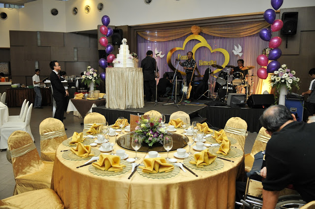 The banquet restaurant kuching stage vip table orange golden table cloth junglespirit Image collections