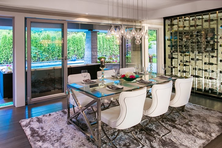 Glass dining table in Contemporary home by Trevor Euley in Canada
