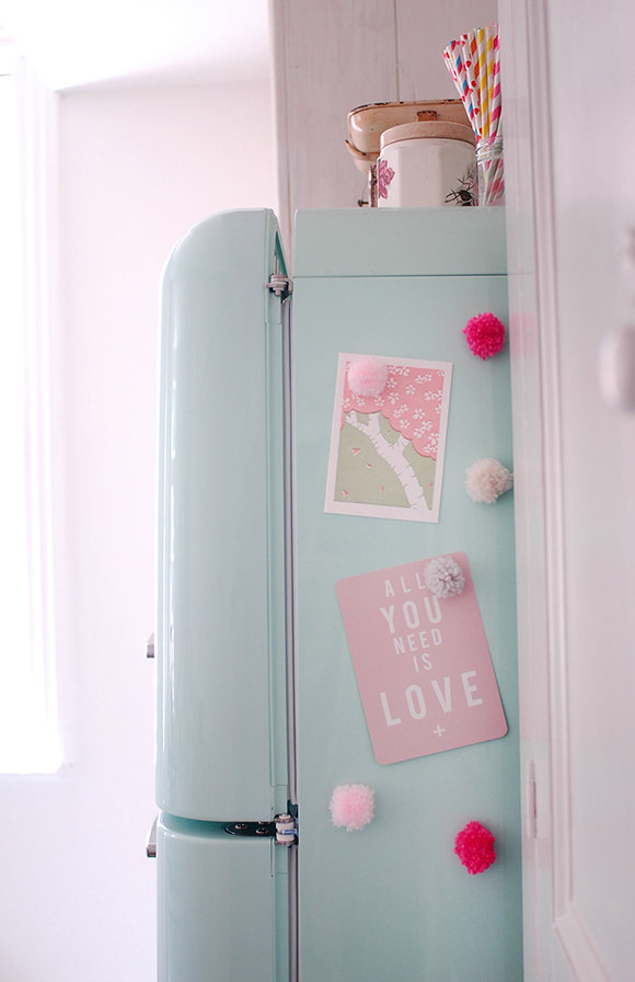 DIY project to make pom pom magnets, displayed on my Smeg fridge!