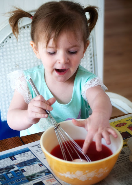 Use a whisk to help kids dye eggs without breaking them