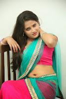 Anusha sizzling Pictures in half saree 067.JPG