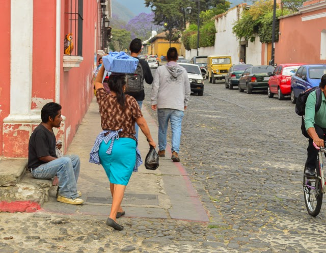Locals walking through the cobblestone streets of Antigua