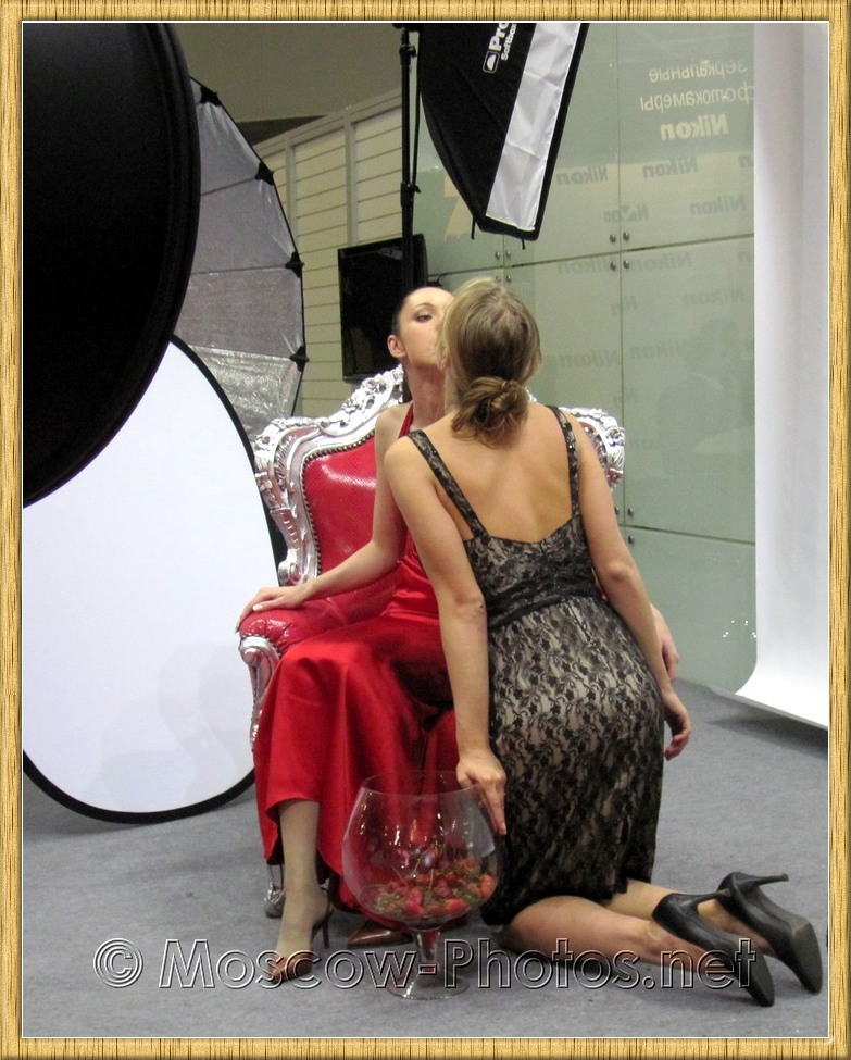 Kissing models at Photoforum - 2010, Moscow