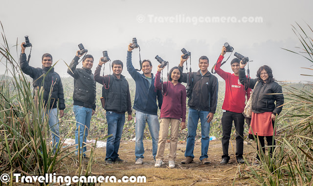 On 15th Jan, we planned a Photo-Walk to Okhla Bird Sanctuary with Adobe friends. This Photo Journey shares some of the main experiences of Okhla Bird Sanctuary and few basic tips about planning a visit to this place near Noida. let's check out more photographs & know more.The Okhla Bird sanctuary is near Noida and there are enough water-birds. In 1990, an area of 3.5 square kilometres on the river Yamuna was notified as a bird sanctuary by the Uttar Pradesh government under the Wildlife Protection Act of India.  The most prominent feature of the sanctuary is the large lake created by damming the river, which lies sandwiched between Okhla village towards the west and Gautam Budh Nagar towards the east.We left from office at 8:00 am in the morning and reached this place by 8:15am. While going from center from the Noida, we crossed Mahamaya flyover and then took first right cut after flyover. Okhla Bird Sanctuary gate is just in front of this cut onlyIt was very foggy in the morning which created more excitement and a little disappointment :). Overall, most of us were not much worried about the these things as everyone was geared up to faces such challenges. After just entering into the sanctuary we saw huge water body on our left. There were plenty of birds in these water ponds. Space inside was very clean and impressive. None of us were expecting such experience and now we know a good option around Noida for quick walk or fun.There is a well maintained road surrounded by green areas and birds whistling all around. A wonderful environment and fog added more value to it. More than bird photography, this place gave us oopportunities to try landscapes.There is an entry fees of 30 Rs per person and 100 rs for car entry. After getting inside, we chose to walk with cameras and cars were parked. Ideal place to park cars inside Okhla Bird Sancturay is near Banyan tree from where we can go to different machans for bird-watching in deep areas of the sanctuary and high grass bir