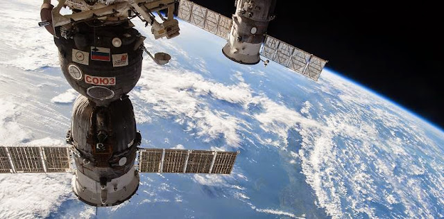 Progress cargo craft (right) is seen docked to the International Space Station. Credit: NASA