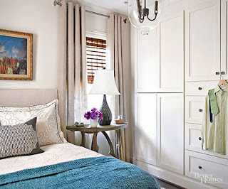 camera da letto piccola con mobili arrotondati immagine