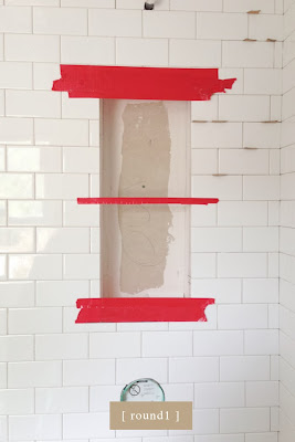 traditional bathroom. marble shower niche.