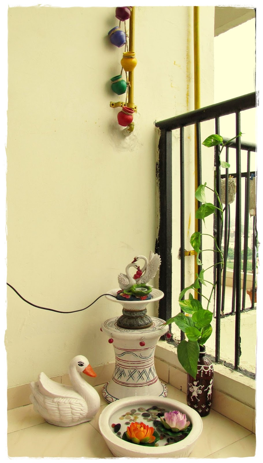 Indian small balcony garden - These Five Hanging Pots Are Just Rabdi Handis Which I Have Painted They Look So Vibrant And Enhance The Beauty Of Her Small Balcony Garden