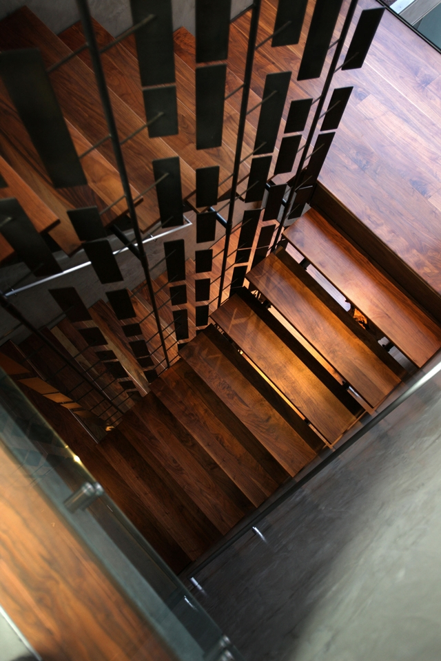 Picture of wooden staircase as seen from the upper floor
