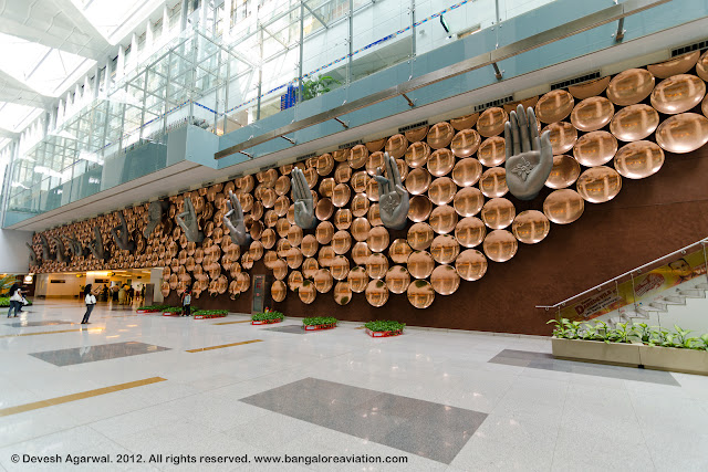 "The famous ""mudra"" wall at Terminal 3. Mudras are hand gestures used in classical Indian dance forms."