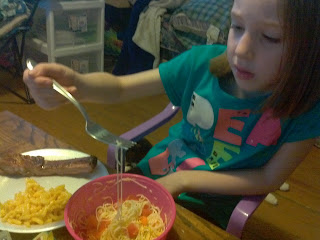 My 6 year old sampling her brilliant recipe