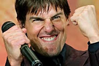 Tom Cruise smirking and laughing