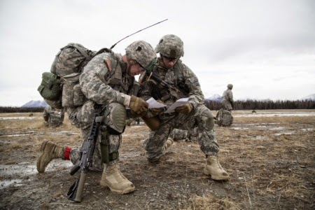 U.S. Army 1st Sgt. Raymond S. Middleton, left, and Capt. Michael A. Mccaughey, 2nd Battalion, 377th Parachute Field Artillery Regiment, 4th Infantry Brigade Combat Team (Airborne), 25th Infantry Division, conduct forced-entry parachute assault training on Malemute drop zone at Joint Base Elmendorf-Richardson, Alaska, March 18, 2015, as part of a larger tactical field exercise. The Soldiers are part of the Army's only Pacific airborne brigade with the ability to rapidly deploy worldwide, and are trained to conduct military operations in austere conditions. (U.S. Air Force photo/Alejandro Pena)