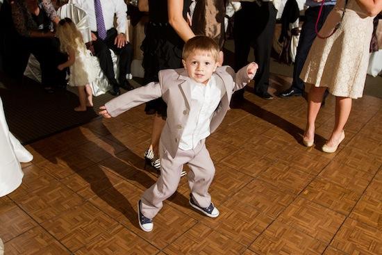 ring bearer dancing at reception
