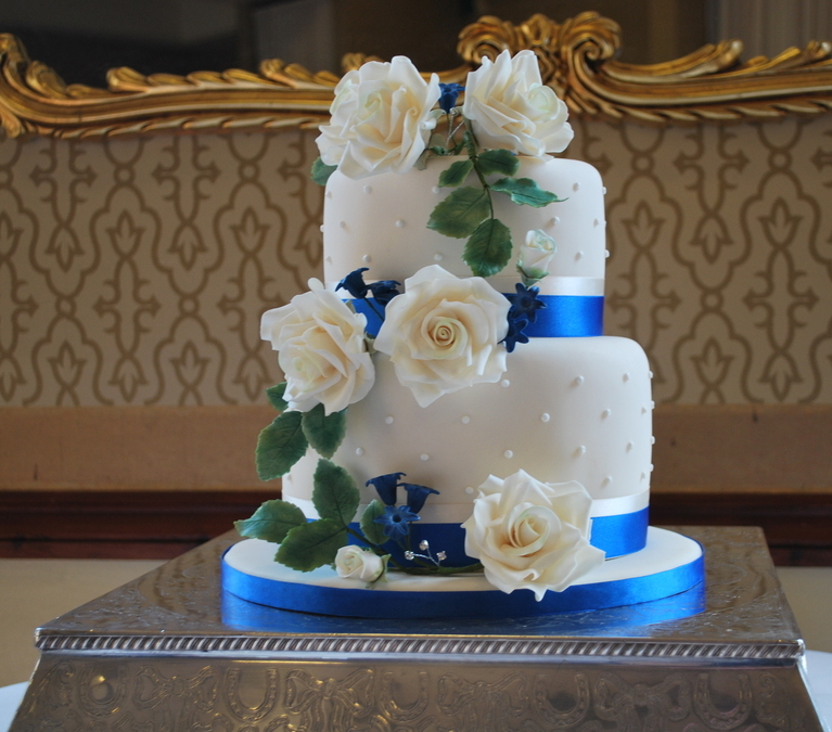 Cream rose &; blue hyacinth pip wedding cake