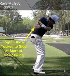 Rory McIlroy golf swing downswing with right elbow tucked to side belt buckle facing target