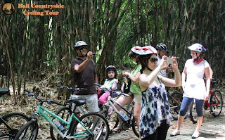 Family Ride and take picture inside Bamboo Forest Bali Countryside Cycling Tour Tracks