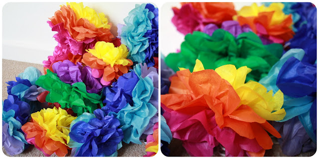 Paper pom poms - use folded tissue paper to create these fun party decorations.  I created these for my Cinco de Mayo birthday BBQ