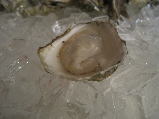 naked oyster on the half shell on ice