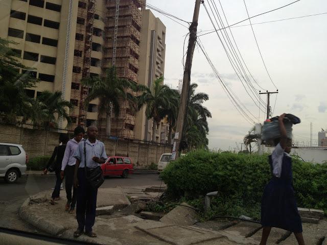 Nigerians walking down street in Lagos