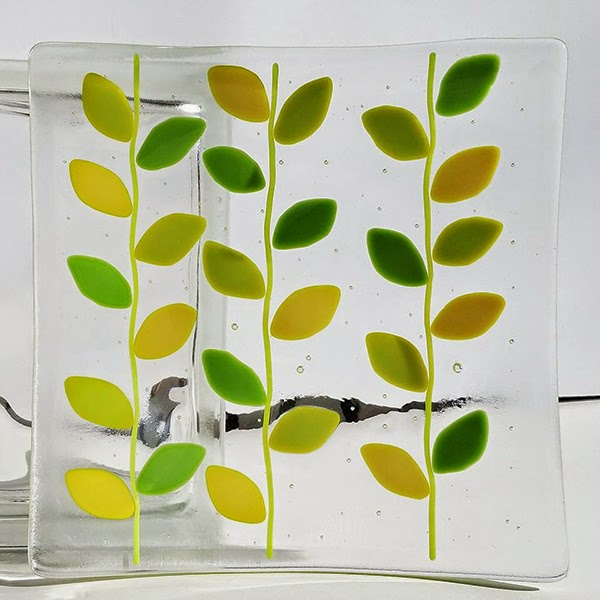 Sassy Glass Studio creates one-of-a-kind fused glass art like this folk art design plate