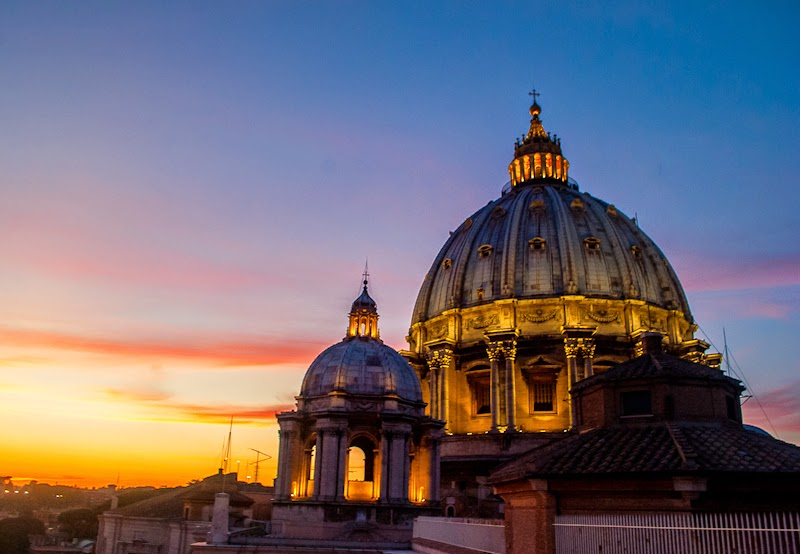 sunset behind the vatican dome