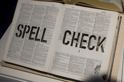 spell check stamped in a dictionary