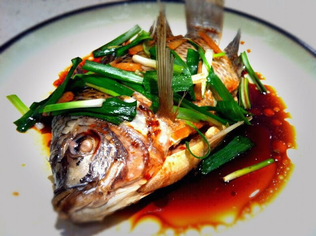 Cantonese steamed fish recipe whole tilapia on the table for Whole fish recipes