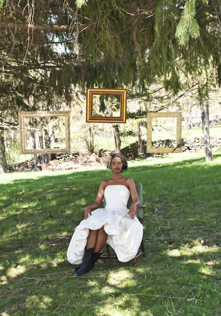 Vintage Rustic Farm Wedding Catskills shot by fine art wedding photographer Angela Cappetta bride sits on the garden among hung frames