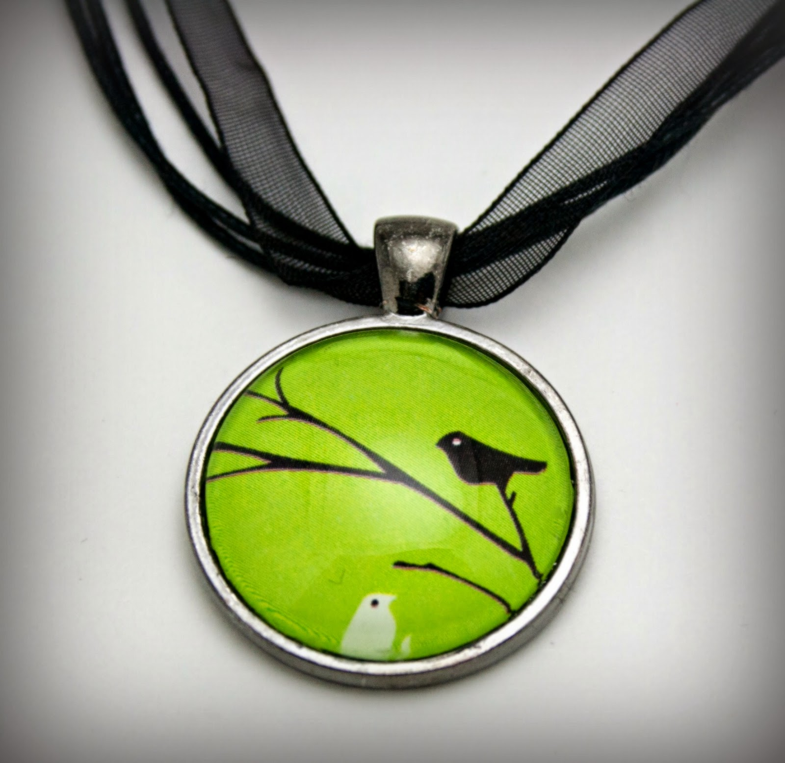 https://www.etsy.com/listing/188434183/bird-on-branch-necklace-glass-pendant?ref=shop_home_active_11