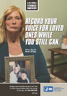 "Poster reads, ""A TIP FROM A FORMER SMOKER. RECORD YOUR VOICE FOR LOVED ONES WHILE YOU STILL CAN. Terrie, Age 52, North Carolina."" There is a additional text below, but it is too small to read."