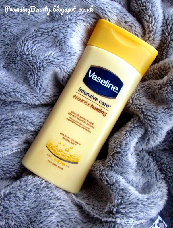 Vaseline intensive care essential healing body lotion. Yellow bottle of lotion.