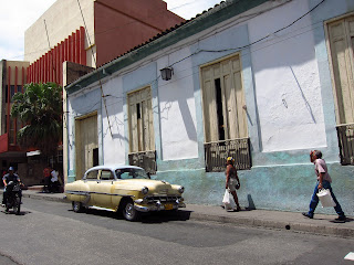 Santiago de Cuba street cream color car people walking
