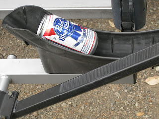 Empty beer can in bike rack tire well.