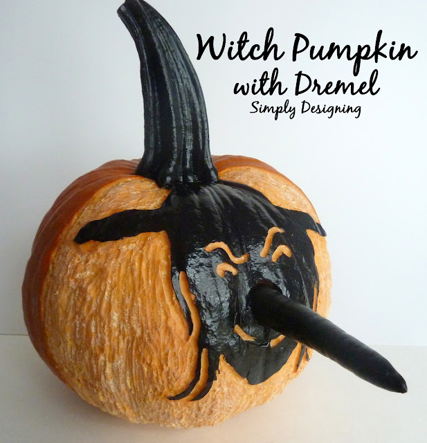 Witch Pumpkin Carved using a Dremel and Painted | Simply Designing #halloween #pumkins #pumkincarving #witch #dremel #ilovepowertools