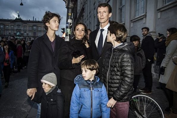 Prince Joachim of Denmark, Princess Marie of Denmark and their children prays tribute to victims in front of the French embassy in Copenhagen