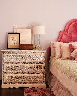 The lovely rish pink velvet on the French provincial upholstered headboard really catches the eye and adds another layer of comfort and elegance to this bedroom.